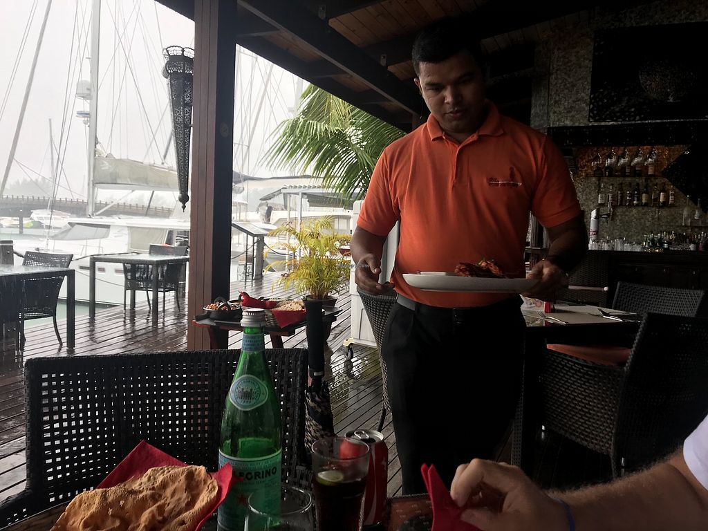 """Photo of The Maharajas  by <a href=""""/members/profile/SoniaGivray"""">SoniaGivray</a> <br/>Nice Indian waiter, take good care of us <br/> December 20, 2017  - <a href='/contact/abuse/image/107329/337472'>Report</a>"""
