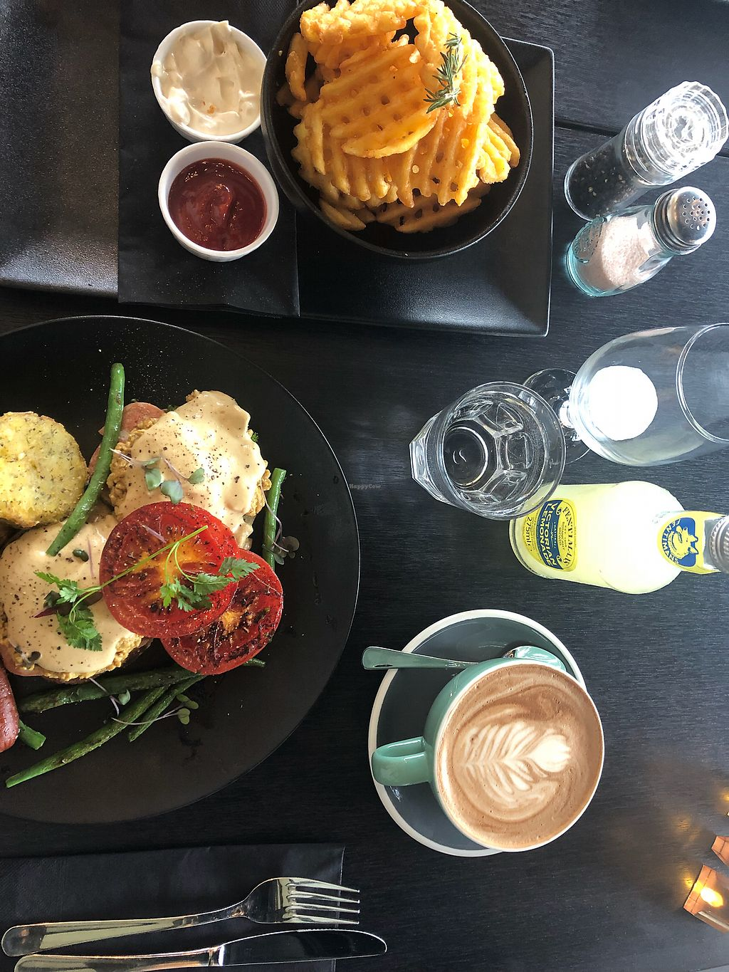 "Photo of Raw Sugar Cafe  by <a href=""/members/profile/AndreaKrause"">AndreaKrause</a> <br/>Waffle fries with vegan miso and garlic mayo and vegan eggs Benedict. Also a coconut mocha  <br/> March 11, 2018  - <a href='/contact/abuse/image/107404/369138'>Report</a>"