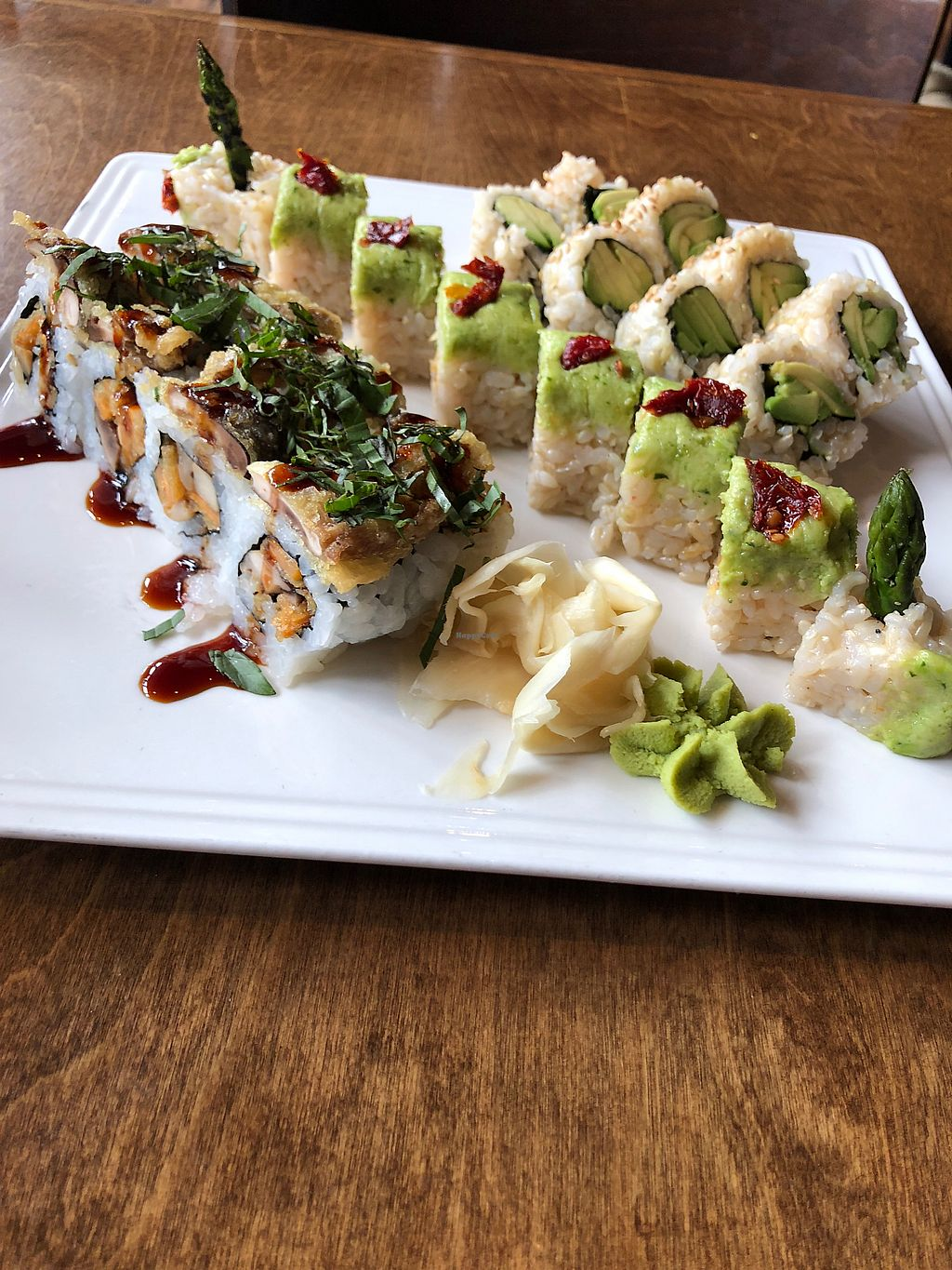 """Photo of Blue Sushi Sake Grill  by <a href=""""/members/profile/EricaMcMahon"""">EricaMcMahon</a> <br/>Three vegan sushi rolls! Shiitake to me, an avocado asparagus, and an avocado :)  <br/> April 6, 2018  - <a href='/contact/abuse/image/107415/381686'>Report</a>"""