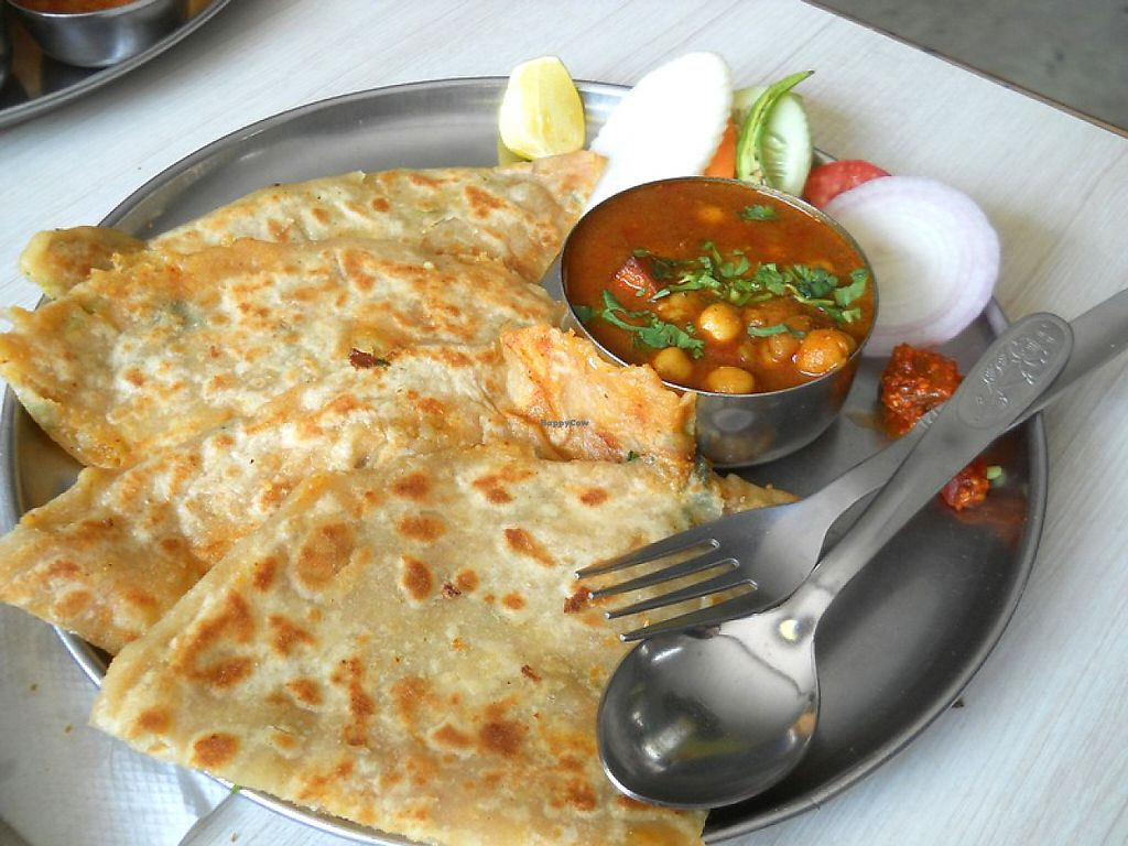 "Photo of Rameshwaram - New Rd  by <a href=""/members/profile/Masala-Dosa"">Masala-Dosa</a> <br/>Alu Paratha with Cholay <br/> June 6, 2017  - <a href='/contact/abuse/image/10764/266248'>Report</a>"
