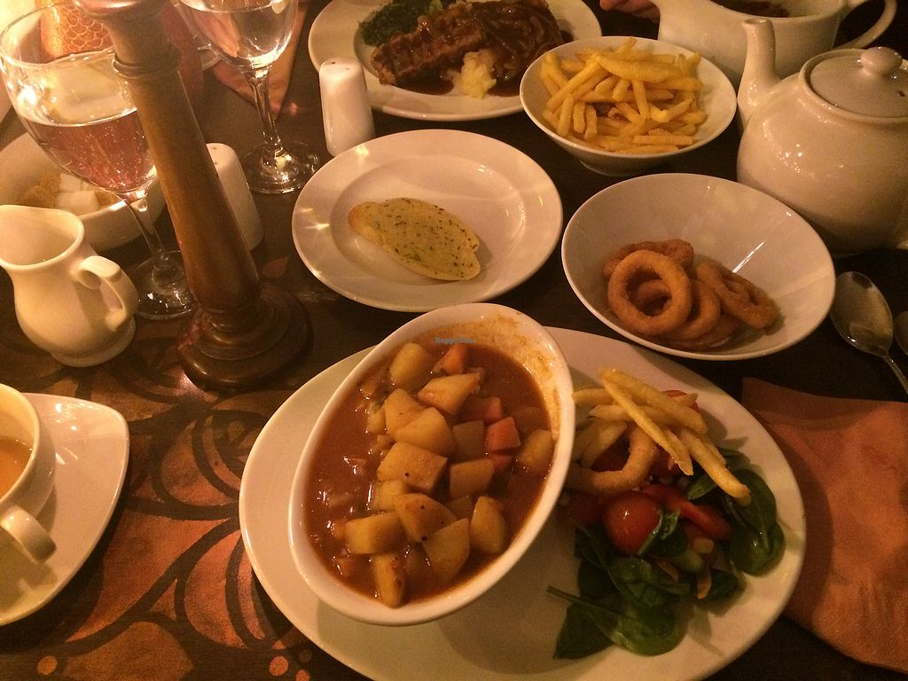 Photo of Phoenix Plant Based Eatery  by lemontena <br/>Iranian stew, onion rings, chips, 'sausage', mash and gravy <br/> January 19, 2018  - <a href='/contact/abuse/image/107714/348559'>Report</a>