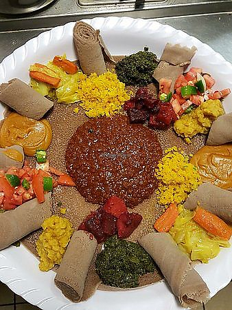 "Photo of Hiwot Ethiopian Restaurant  by <a href=""/members/profile/aidalove"">aidalove</a> <br/>7 veggie combo - all vegan <br/> December 24, 2017  - <a href='/contact/abuse/image/107837/338558'>Report</a>"