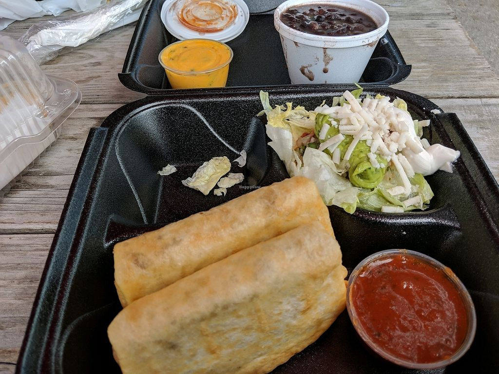 """Photo of Nacho Taco  by <a href=""""/members/profile/BryanRoseberry"""">BryanRoseberry</a> <br/>Vegan soy chicken chimichanga with vegan cheese and sour cream <br/> February 28, 2018  - <a href='/contact/abuse/image/108088/364757'>Report</a>"""