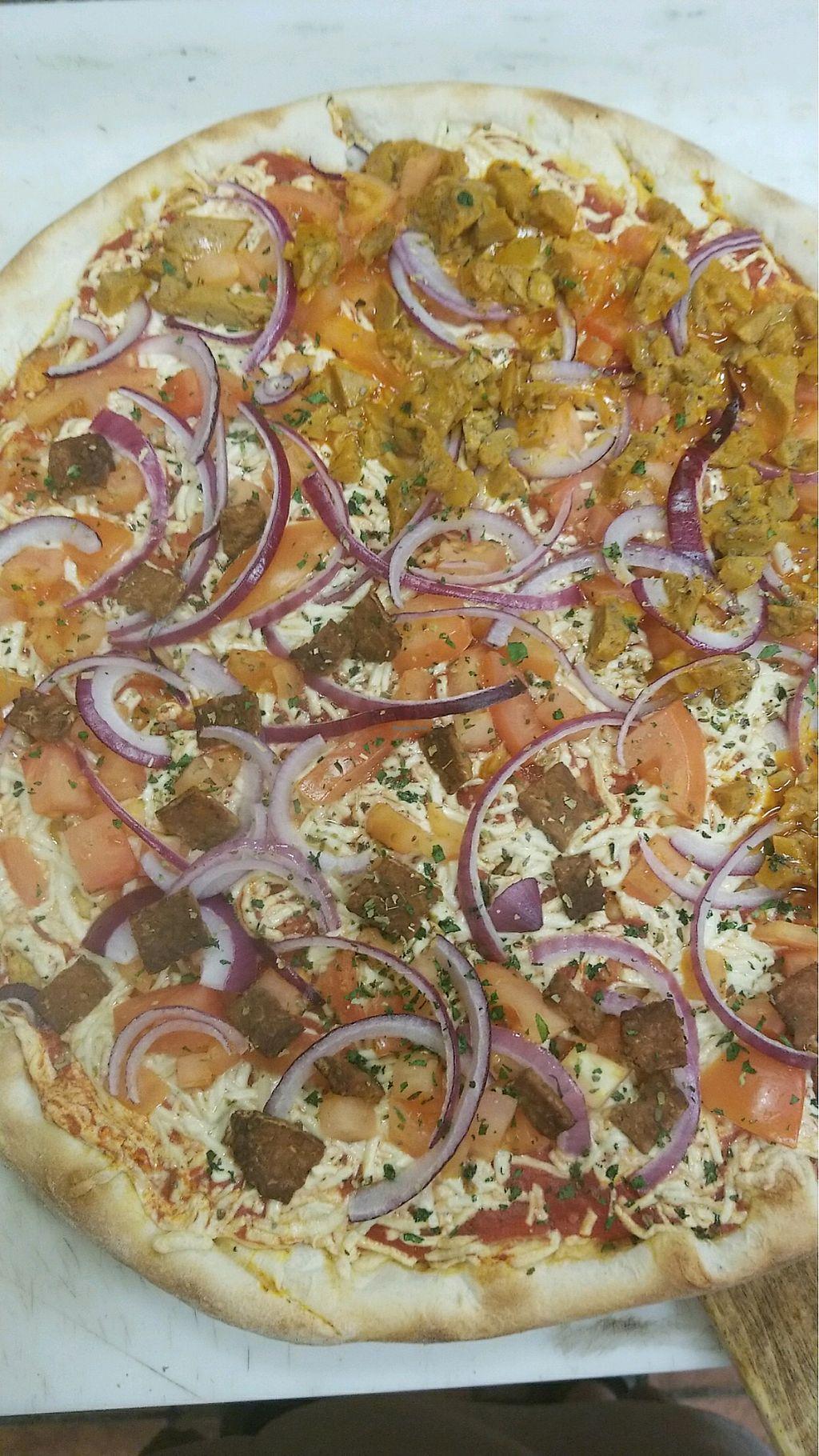 "Photo of Pizza Mia  by <a href=""/members/profile/ErinO%E2%80%99Brien"">ErinO'Brien</a> <br/>Half tempeh Facon with red onions and tomatoes, half buffalo seitan fajita with red onion and tomato  <br/> January 8, 2018  - <a href='/contact/abuse/image/108250/344184'>Report</a>"
