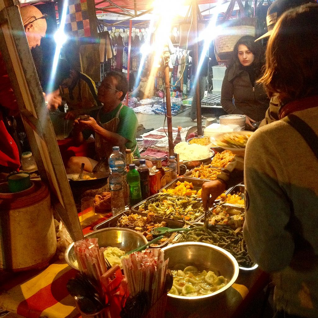 """Photo of Vegan Buffet at Luang Prabang Night Market  by <a href=""""/members/profile/AndyCB"""">AndyCB</a> <br/>Pick your food, and the guy in the green shirt heats it in a wok! <br/> January 13, 2018  - <a href='/contact/abuse/image/108363/346121'>Report</a>"""