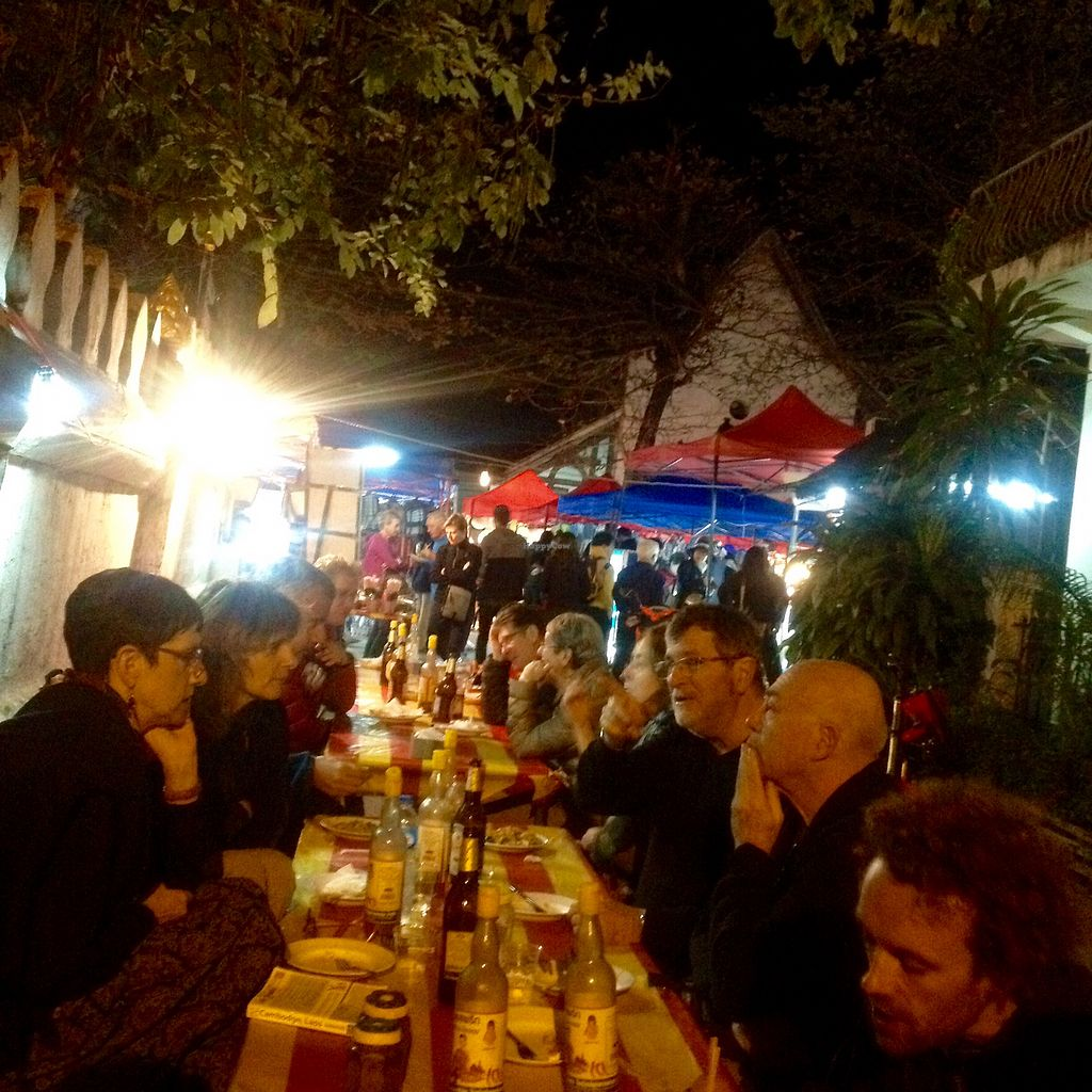 """Photo of Vegan Buffet at Luang Prabang Night Market  by <a href=""""/members/profile/AndyCB"""">AndyCB</a> <br/>Eat at a communal table down the side street <br/> January 13, 2018  - <a href='/contact/abuse/image/108363/346122'>Report</a>"""