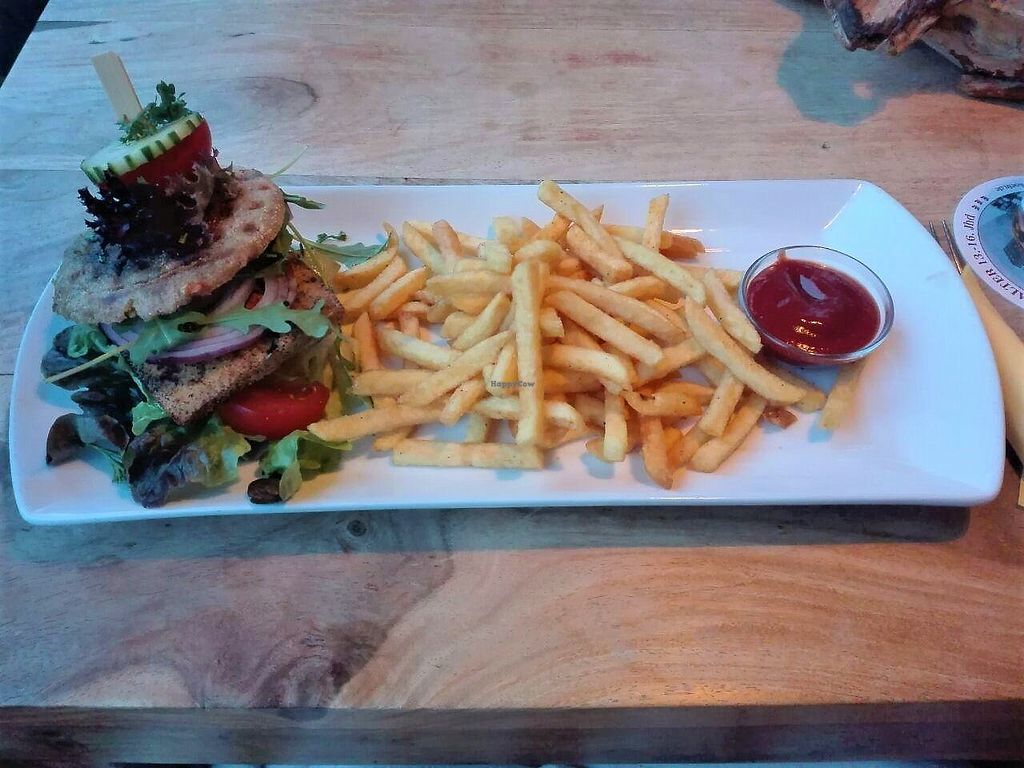 """Photo of Cafe Voigt  by <a href=""""/members/profile/Claudi"""">Claudi</a> <br/>The vegan burger from Cafe Voigt: a seasoned and fried piece of tofu with fresh greens on a toasted bun <br/> January 10, 2018  - <a href='/contact/abuse/image/108430/344991'>Report</a>"""