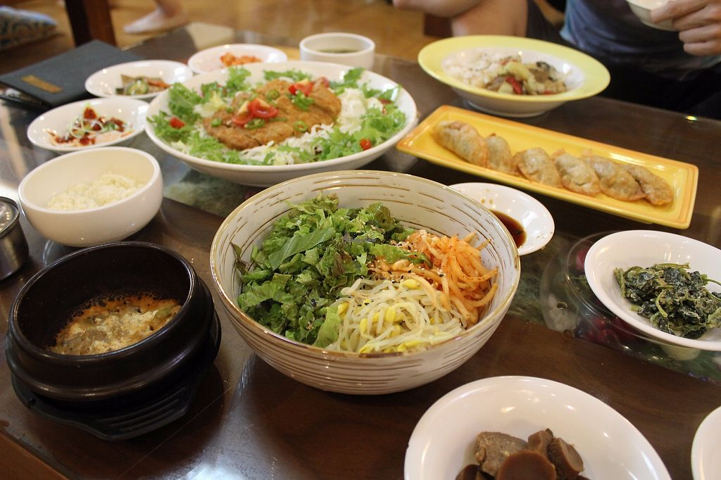 "Photo of Oh Se Gae Hyang - 오세계향  by <a href=""/members/profile/taylor8294"">taylor8294</a> <br/>Bimibap, fried dumplings, vege BBQ and the soy cutlet <br/> August 1, 2017  - <a href='/contact/abuse/image/10860/287550'>Report</a>"