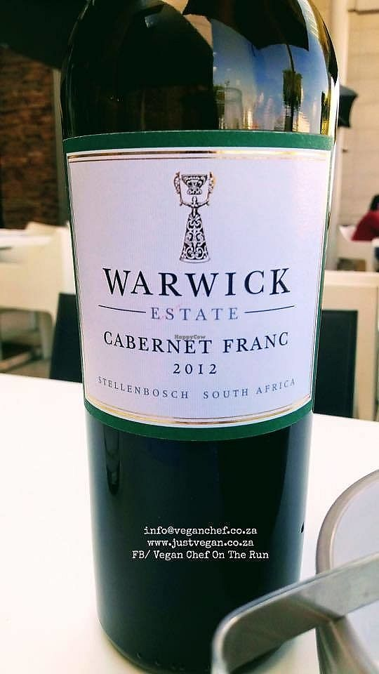"""Photo of Mezepoli Nicolway  by <a href=""""/members/profile/%C5%A0%C3%A1rkaHedstr%C3%B6m"""">ŠárkaHedström</a> <br/>I'm happy to add that the Warwick Cab Franc is #vegan. Indeed as is their Three Cape Ladies, as well as The Trilogy. All lovely wines and most enjoyable. As far as I am aware, this one here, is one of South Africa's top 10 wines, and can be enjoyed at Mezepoli - meze and wine bar, which is where we picked this up. They have a lovely wine list but be sure to bring extra cash, nothing on offer on the lower cost effective vegan end. We enjoy venturing out, and spoiling ourselves on the odd occasion, this bottle set us back R590.00. If their wine list offered a lower end red vegan option for around R150.00, we would frequent more often because their vegan food options are more than satisfying  <br/> January 12, 2018  - <a href='/contact/abuse/image/108616/345848'>Report</a>"""