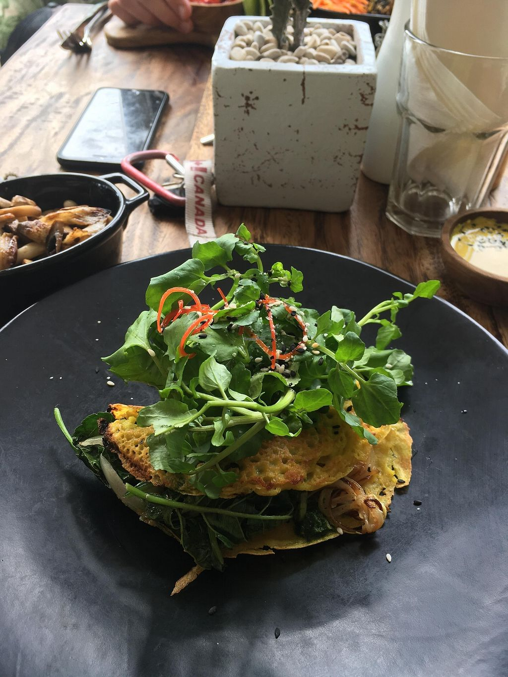 """Photo of Two Trees Eatery  by <a href=""""/members/profile/emmarosewitched"""">emmarosewitched</a> <br/>The vegan chickpea omelette: served with coconut cheese, fried spinach,  potatoes (inside omelette) and greens.  <br/> January 7, 2018  - <a href='/contact/abuse/image/108911/343868'>Report</a>"""