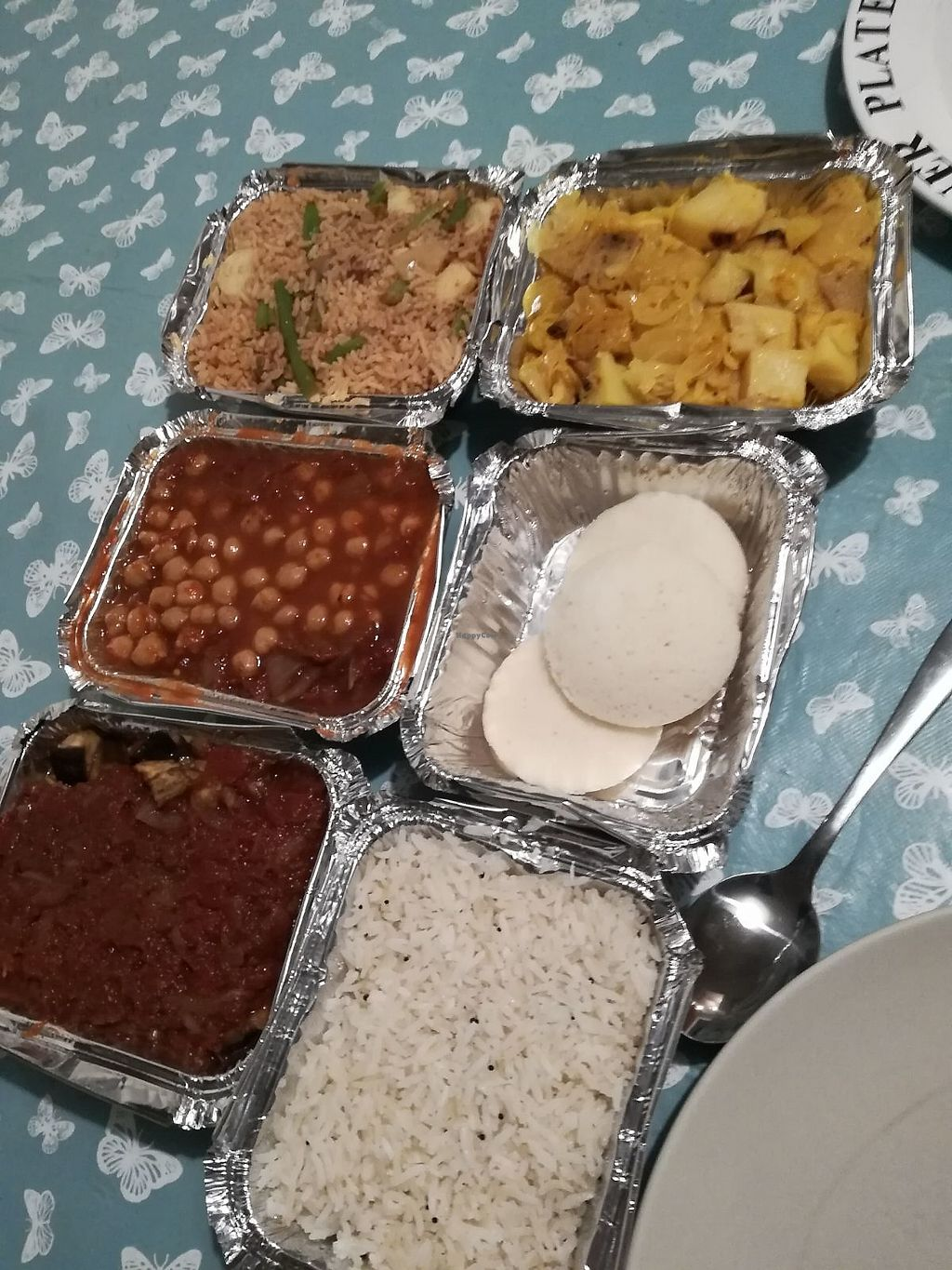 "Photo of Vegan Takeaway  by <a href=""/members/profile/starcide"">starcide</a> <br/>Clockwise from top left : biryani, aloo rai, idly, coconut rice, brinjal masala,  chana masala,  <br/> January 20, 2018  - <a href='/contact/abuse/image/108949/348964'>Report</a>"