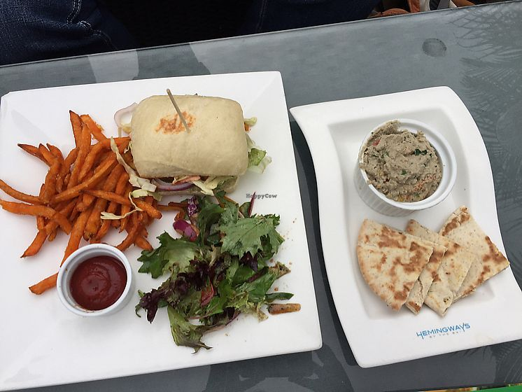 "Photo of Hemingway's By The Bay  by <a href=""/members/profile/Ashni"">Ashni</a> <br/>pulled jackfruit burger (with sweet potato fries and side salad) and babaganoush dip <br/> February 17, 2018  - <a href='/contact/abuse/image/108974/360281'>Report</a>"