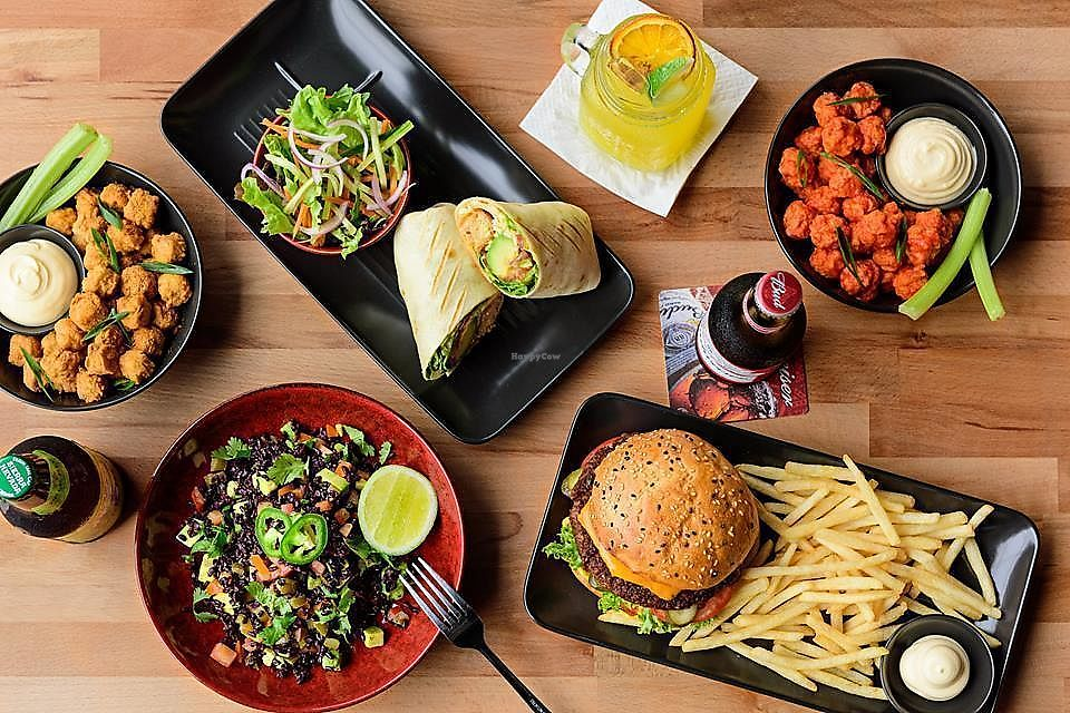 """Photo of The Sporting Globe  by <a href=""""/members/profile/Herbivoracious"""">Herbivoracious</a> <br/>Vegan dishes @Sporting Globe Richmond: Shows VFC bites with Fry's chickn pops, Can't believe it's not beef burger with Hungry Planet beefless patty & Sheese; Buddha Bowl & Free-cken wrap with Hungry Planet chick'n and Sheese <br/> January 9, 2018  - <a href='/contact/abuse/image/108979/344842'>Report</a>"""