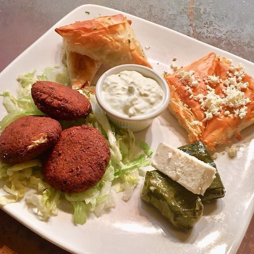 """Photo of Kafe Neo  by <a href=""""/members/profile/Jynn"""">Jynn</a> <br/>Vegetarian Combo Dinner. Spanakopita (cheese & spinach), tyropita (cheese & egg), veggie dolmathes, falafel & tzatziki sauce.  <br/> February 12, 2018  - <a href='/contact/abuse/image/109049/358602'>Report</a>"""