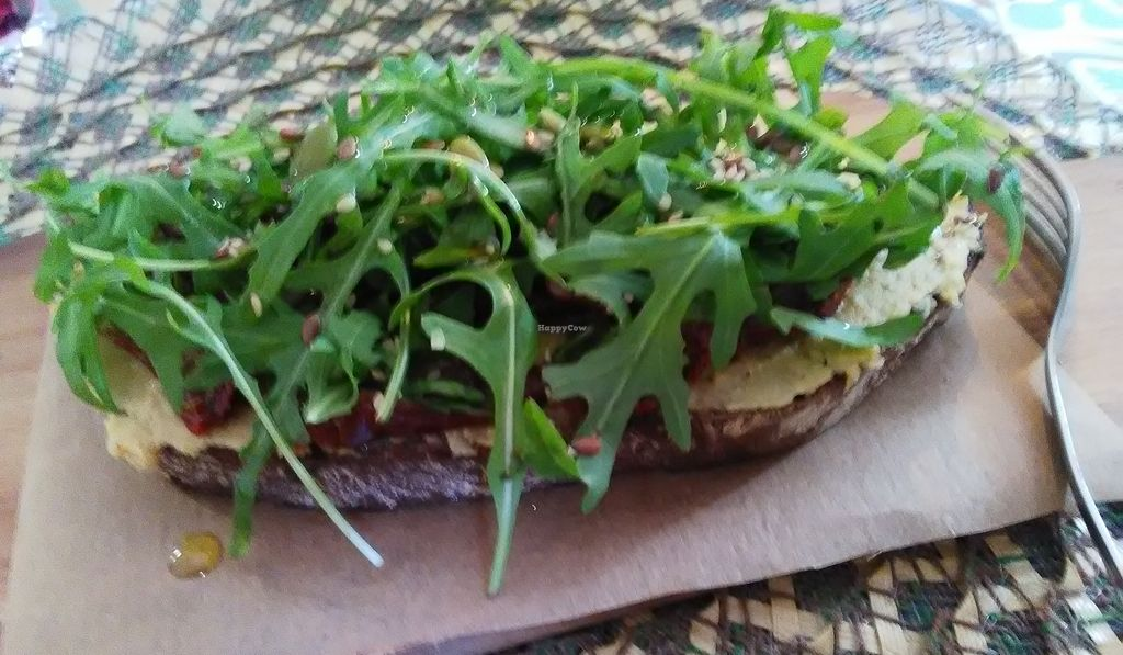 """Photo of Dona Flor Café - Chiado  by <a href=""""/members/profile/Tcharls"""">Tcharls</a> <br/>Delicious Tartine with hummus, dry tomatoes, a pile of  rocket, and olive oil! simple, and efficient <br/> May 11, 2018  - <a href='/contact/abuse/image/109088/398316'>Report</a>"""
