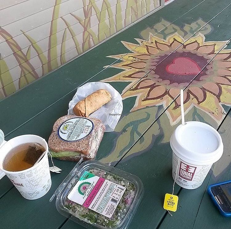 """Photo of Sunflower Natural Foods  by <a href=""""/members/profile/happyhippieellie"""">happyhippieellie</a> <br/>Even the picnic tables outside have sunflowers on them! Here is a spring roll, vegetarian chicken salad, cranberry quinoa salad, and some complimentary teas! <br/> January 9, 2018  - <a href='/contact/abuse/image/109092/344778'>Report</a>"""