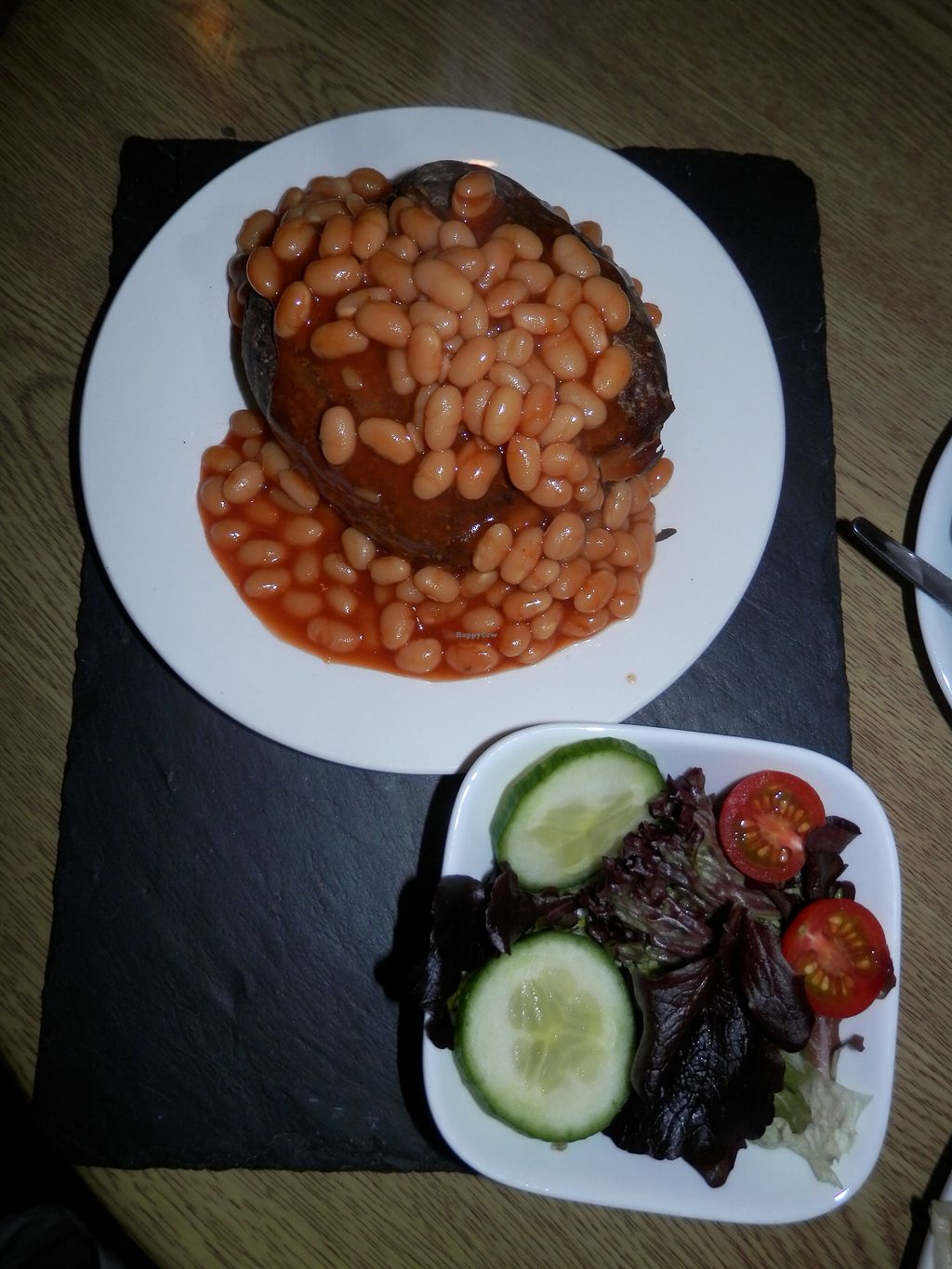 "Photo of Penelope's Cafe   by <a href=""/members/profile/Vegan_Belle"">Vegan_Belle</a> <br/>Jacket potato with baked beans and salad <br/> January 12, 2018  - <a href='/contact/abuse/image/109247/345718'>Report</a>"