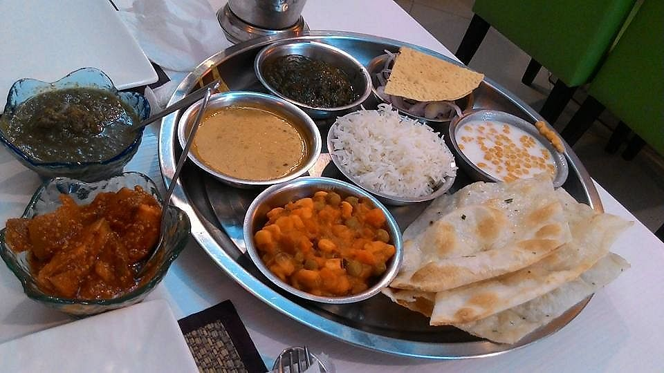 """Photo of Chotivala  by <a href=""""/members/profile/Trambau"""">Trambau</a> <br/>Mixed dish of Indian traditional food, with green/yellow curry, chapati etc <br/> January 15, 2018  - <a href='/contact/abuse/image/109371/346798'>Report</a>"""