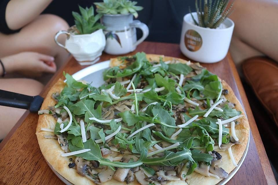 """Photo of Feed Me Pizza  by <a href=""""/members/profile/SeanWard"""">SeanWard</a> <br/>Schiacciata Fungi - sautéed mushroom, garlic, and rocket, lightly sprinkled with vegan cheese.   A lunch special running this summer.  <br/> January 22, 2018  - <a href='/contact/abuse/image/109840/349683'>Report</a>"""