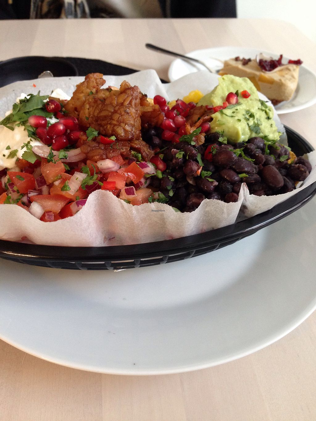 """Photo of Truefood Cafe  by <a href=""""/members/profile/Calandria"""">Calandria</a> <br/>Nachos and mango """"cheese""""cake <br/> March 16, 2018  - <a href='/contact/abuse/image/109958/371428'>Report</a>"""
