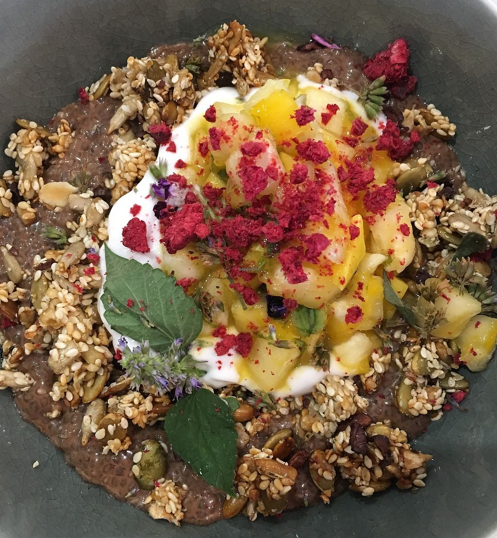 """Photo of Putia Pure Food Kitchen  by <a href=""""/members/profile/Dominiquerizzo"""">Dominiquerizzo</a> <br/>Cacao and coconut chia bowl - a spiced quinoa, nut and banana chia puddings with coconut vanilla bean yoghurt, Cacao nibs, maple and hemp seed crunch, mango, lime and pineapple salsa <br/> January 22, 2018  - <a href='/contact/abuse/image/110126/349670'>Report</a>"""