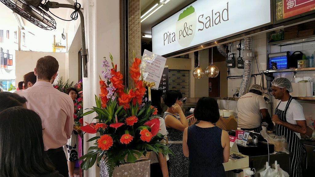 """Photo of Pita&Salad  by <a href=""""/members/profile/JimmySeah"""">JimmySeah</a> <br/>lunch time crowd in front of stall <br/> February 4, 2018  - <a href='/contact/abuse/image/110231/354827'>Report</a>"""