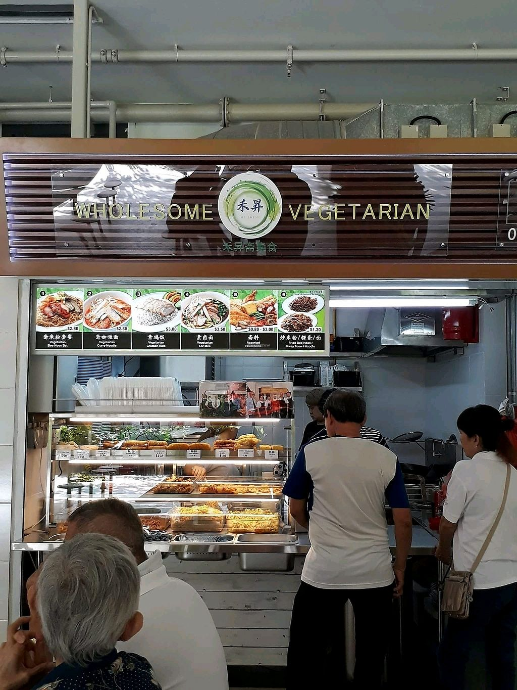 """Photo of Wholesome Vegetarian Stall  by <a href=""""/members/profile/JimmySeah"""">JimmySeah</a> <br/>stall front. photo credit to Sowmya <br/> January 24, 2018  - <a href='/contact/abuse/image/110259/350515'>Report</a>"""