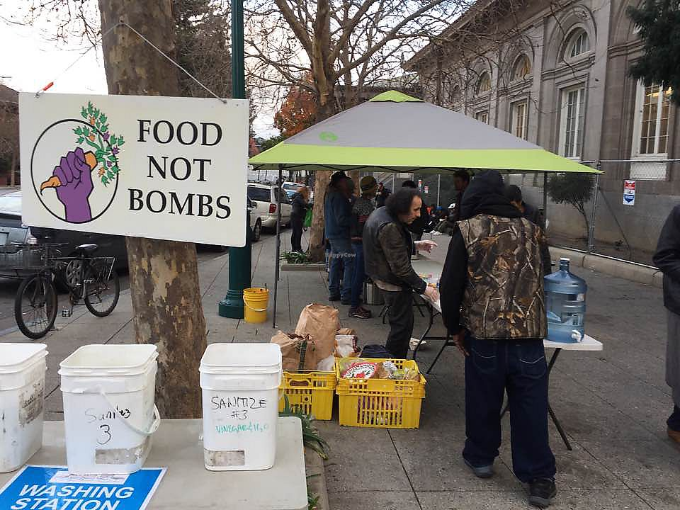 "Photo of Food Not Bombs  by <a href=""/members/profile/KeithMcHenry"">KeithMcHenry</a> <br/>Santa Cruz Food Not Bombs shares every Saturday and Sunday <br/> January 24, 2018  - <a href='/contact/abuse/image/110357/350625'>Report</a>"