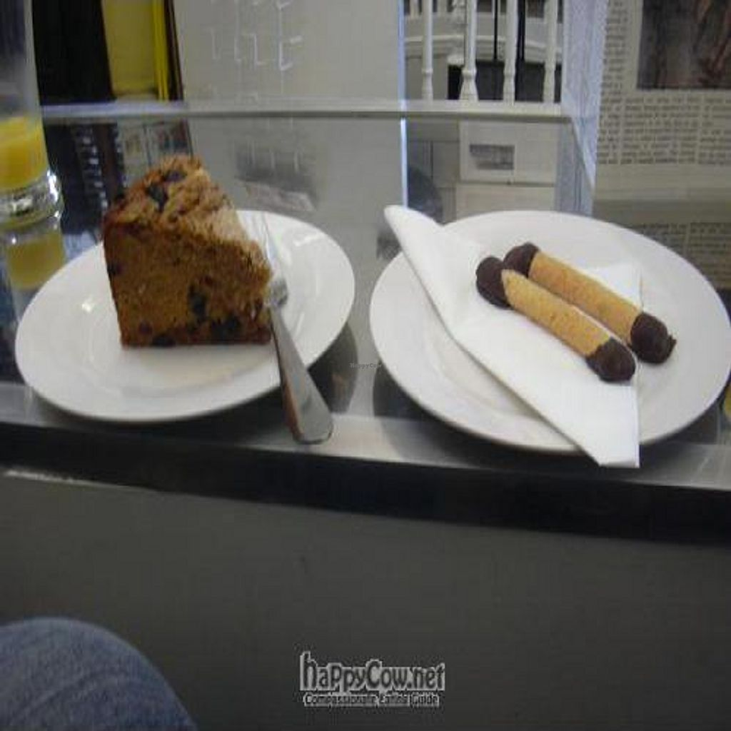 """Photo of CLOSED: The Orrery  by <a href=""""/members/profile/wildfang"""">wildfang</a> <br/>a piece of gluten-free vegan fruit cake and two macaroon fingers <br/> June 2, 2011  - <a href='/contact/abuse/image/11043/8983'>Report</a>"""