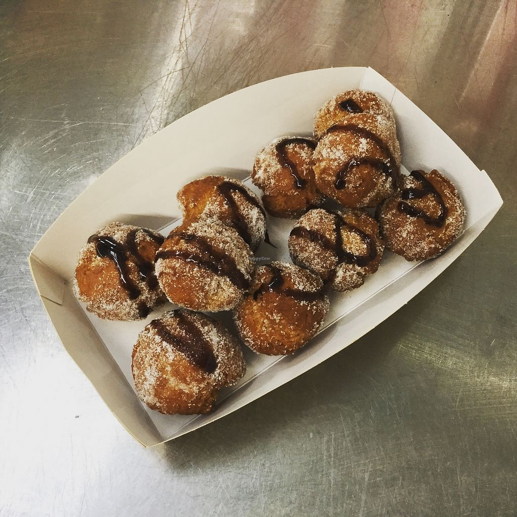 "Photo of CLOSED: V Kitchen - Food Stall  by <a href=""/members/profile/veggiekitchenfr"">veggiekitchenfr</a> <br/>Our vegan donuts drizzled in dark chocolate  <br/> January 28, 2018  - <a href='/contact/abuse/image/110575/351783'>Report</a>"