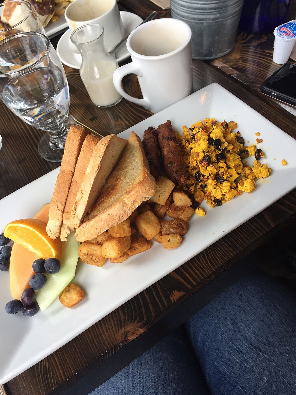 """Photo of L'Gros Luxe  by <a href=""""/members/profile/EricaEff"""">EricaEff</a> <br/>The Classic. VERY small portion of tofu scramble (barely even a 1/3 of the plate). Dry toast since they don't have vegan butter <br/> February 11, 2018  - <a href='/contact/abuse/image/110637/358104'>Report</a>"""
