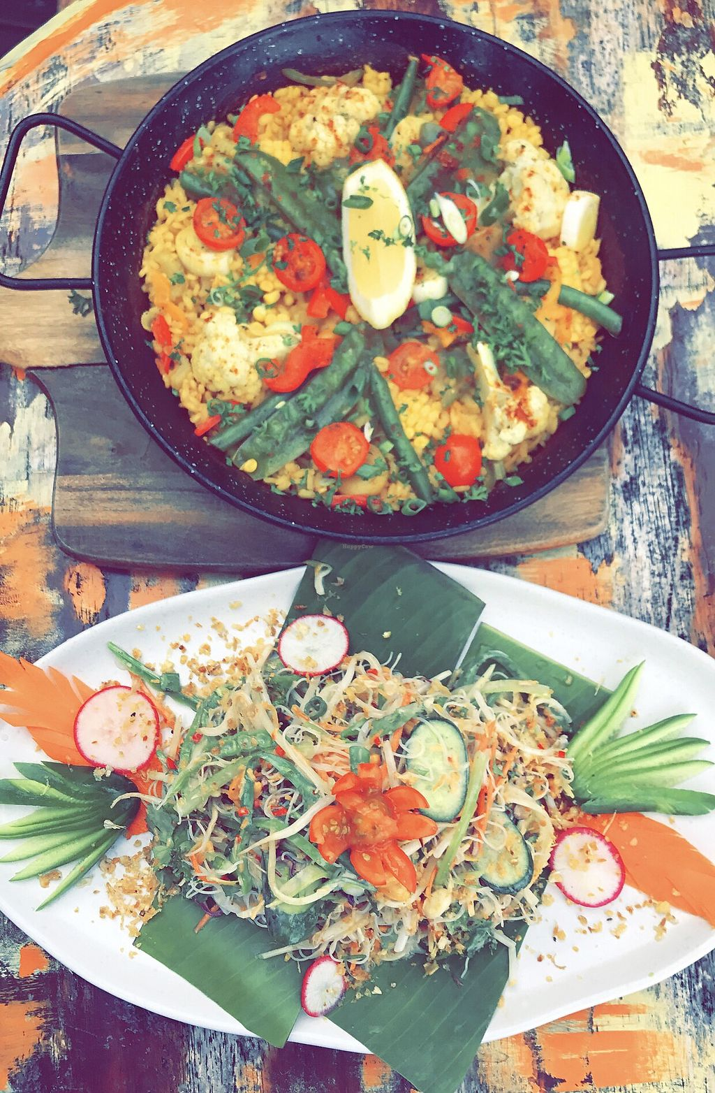 """Photo of Coco Mojo Bar & Grill  by <a href=""""/members/profile/marykochse"""">marykochse</a> <br/>Paella and Thai noodle salad  <br/> February 2, 2018  - <a href='/contact/abuse/image/110952/353998'>Report</a>"""