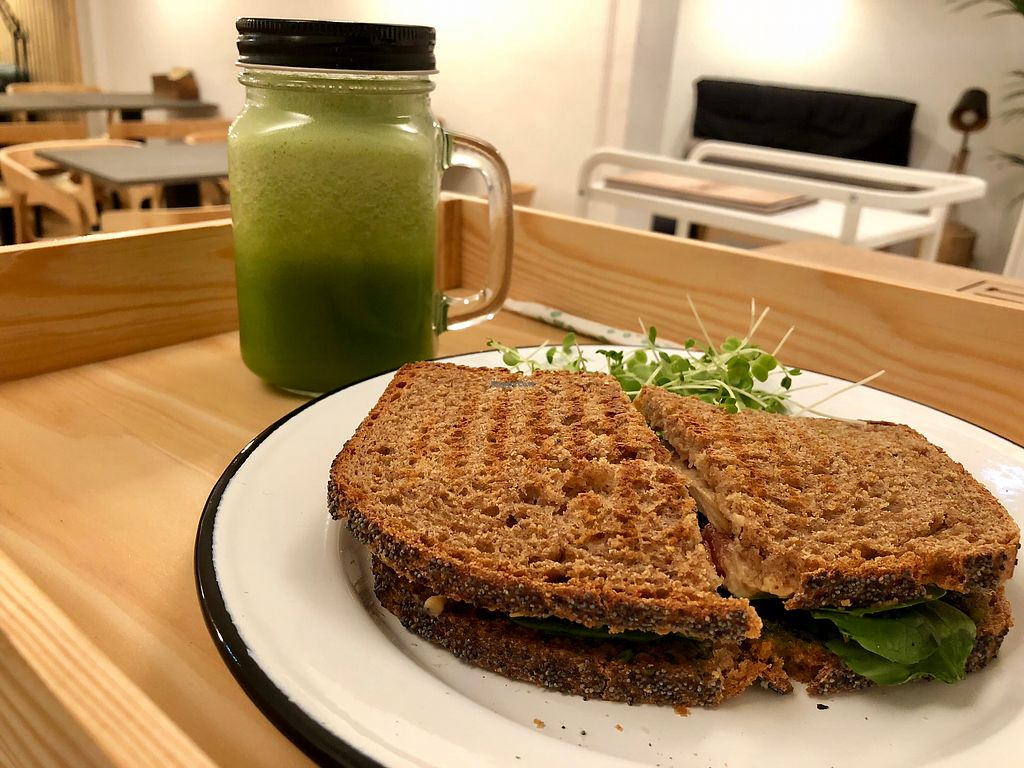 """Photo of Eight - The Health Lounge  by <a href=""""/members/profile/Vera%20Peres"""">Vera Peres</a> <br/>Green juice and cashew cheese toast <br/> February 12, 2018  - <a href='/contact/abuse/image/111218/358369'>Report</a>"""