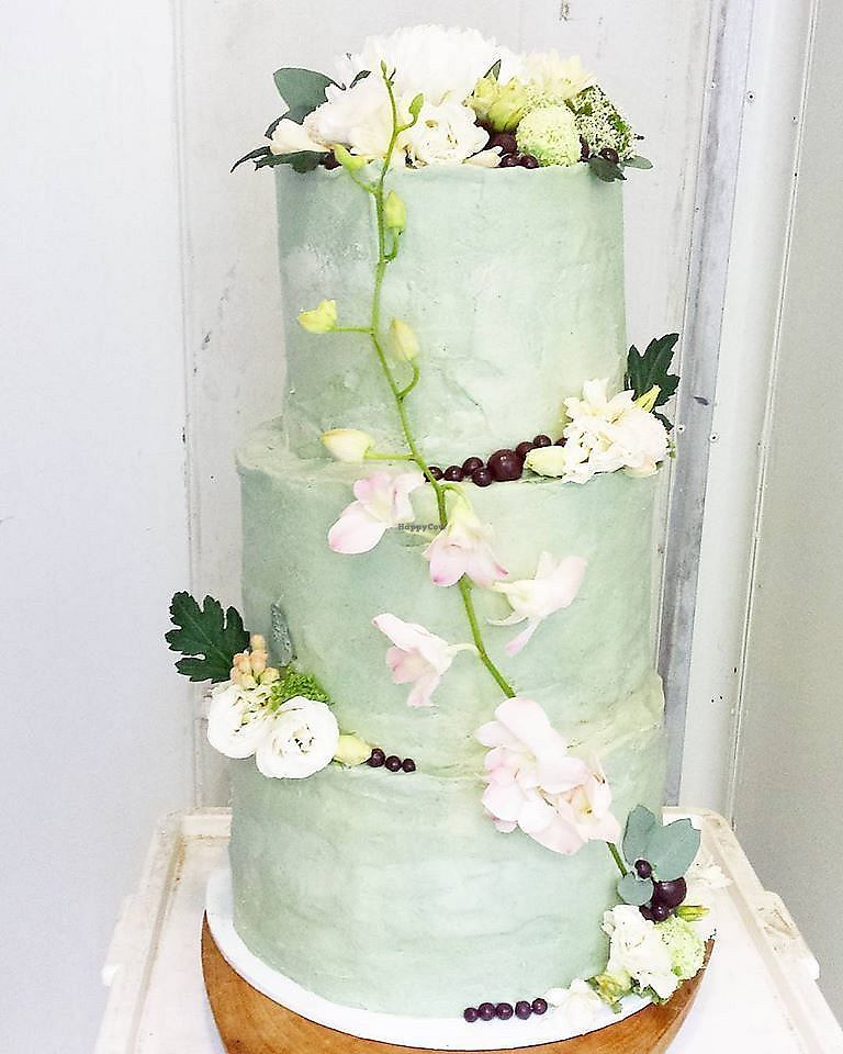 """Photo of Organic Passion Catering  by <a href=""""/members/profile/TattooedByronVegan"""">TattooedByronVegan</a> <br/>A 3-tiered raw vegan cake. One tier was a rich 3 layered chocolate cake, then a white chocolate with raspberry swirl and the 3rd top tier was layered lemon, lime and vanilla <br/> February 12, 2018  - <a href='/contact/abuse/image/111571/358284'>Report</a>"""