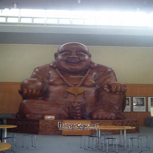 "Photo of SaiShokuKenBi  by <a href=""/members/profile/MissGemma"">MissGemma</a> <br/>The giant wooden Buddha in the hall next to the restaurant building <br/> September 5, 2011  - <a href='/contact/abuse/image/11157/10449'>Report</a>"