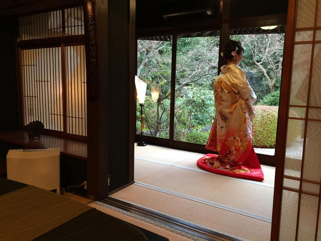 """Photo of Kanga An  by <a href=""""/members/profile/Diggity"""">Diggity</a> <br/>newlywed bride having her wedding photo taken next to our dining room <br/> January 23, 2015  - <a href='/contact/abuse/image/11161/91188'>Report</a>"""