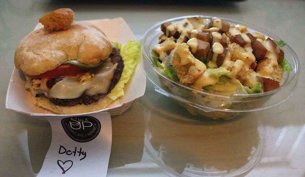 """Photo of Stir It Up  by <a href=""""/members/profile/Chlo%C3%ABWeale"""">ChloëWeale</a> <br/>The Dotty (Messy) Burger: nut patty, """"cheese"""", tomato, lettuce, onion and pickle on 'Breadworks' ciabatta bun. Caesar Salad: Romaine lettuce, house-made facon bits, croutons with the worlds best home-made caesar dressing! <br/> February 12, 2018  - <a href='/contact/abuse/image/111791/358490'>Report</a>"""