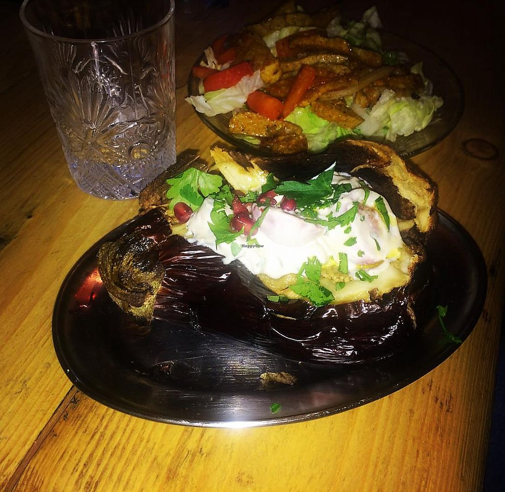 """Photo of Shouk  by <a href=""""/members/profile/Cnagyro"""">Cnagyro</a> <br/>Whole roasted aubergine with tahiny and pomegranate. Vegan <br/> February 14, 2018  - <a href='/contact/abuse/image/111873/359164'>Report</a>"""