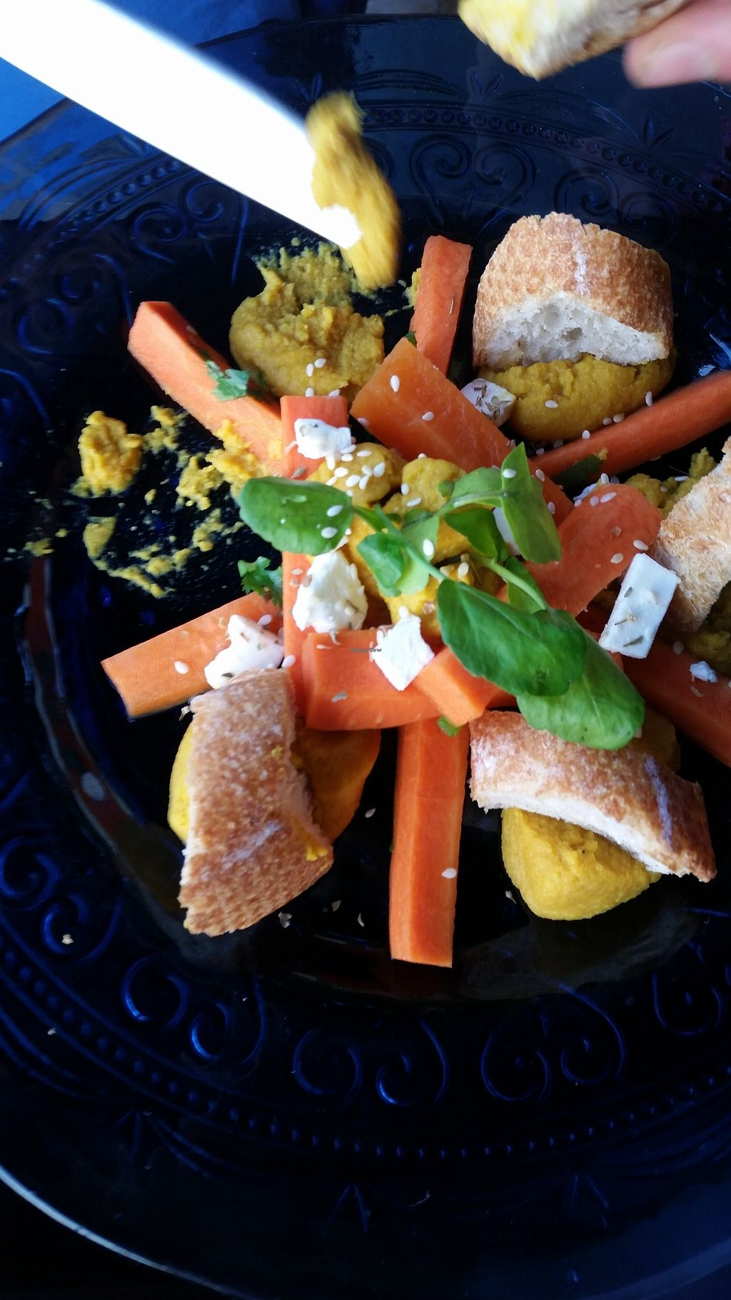 """Photo of Ock Pop Tok Living Craft Centre  by <a href=""""/members/profile/Nimeda"""">Nimeda</a> <br/>Hummus platter with pickled carrots, feta and baguette. Could be veganized by leaving out the baguette (contains eggs according to staff) and feta <br/> February 14, 2018  - <a href='/contact/abuse/image/111949/359053'>Report</a>"""