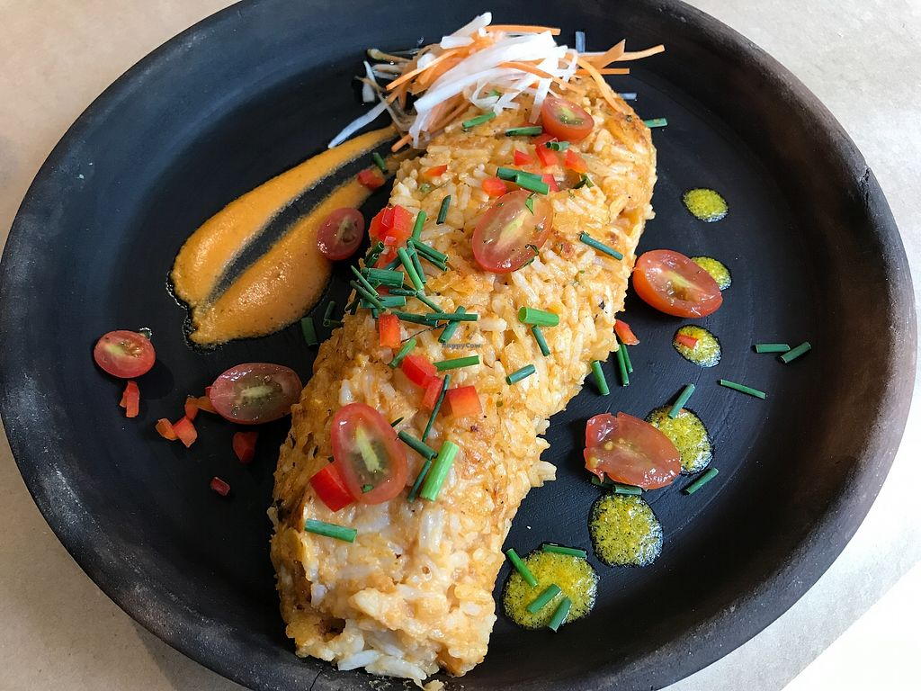 """Photo of De La Llama  by <a href=""""/members/profile/CarlosGarciav"""">CarlosGarciav</a> <br/>Wish I remember the name of this dish - was on the menu as a fish dish, the chef kindly suggested it as a vegan option with a side of plantain and some of their in house chili sauce which was mind blowingly good! <br/> February 21, 2018  - <a href='/contact/abuse/image/112318/362016'>Report</a>"""