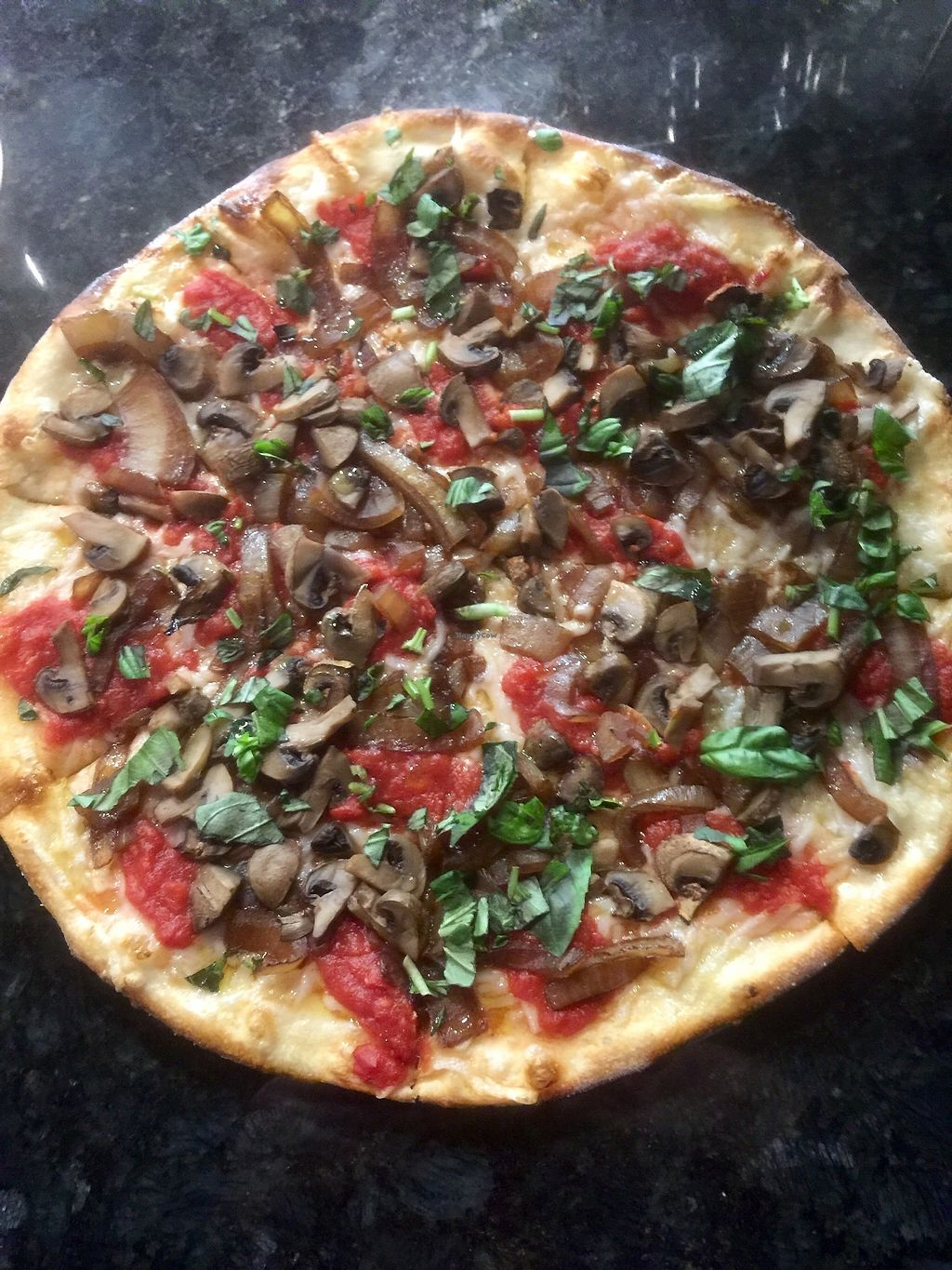 """Photo of Milano Wine Bar & Pizzeria  by <a href=""""/members/profile/aaronwesq"""">aaronwesq</a> <br/>Vegan - Super thin crusted Margherita Pizza with sautéed onions and mushrooms.  <br/> March 14, 2018  - <a href='/contact/abuse/image/112342/370731'>Report</a>"""