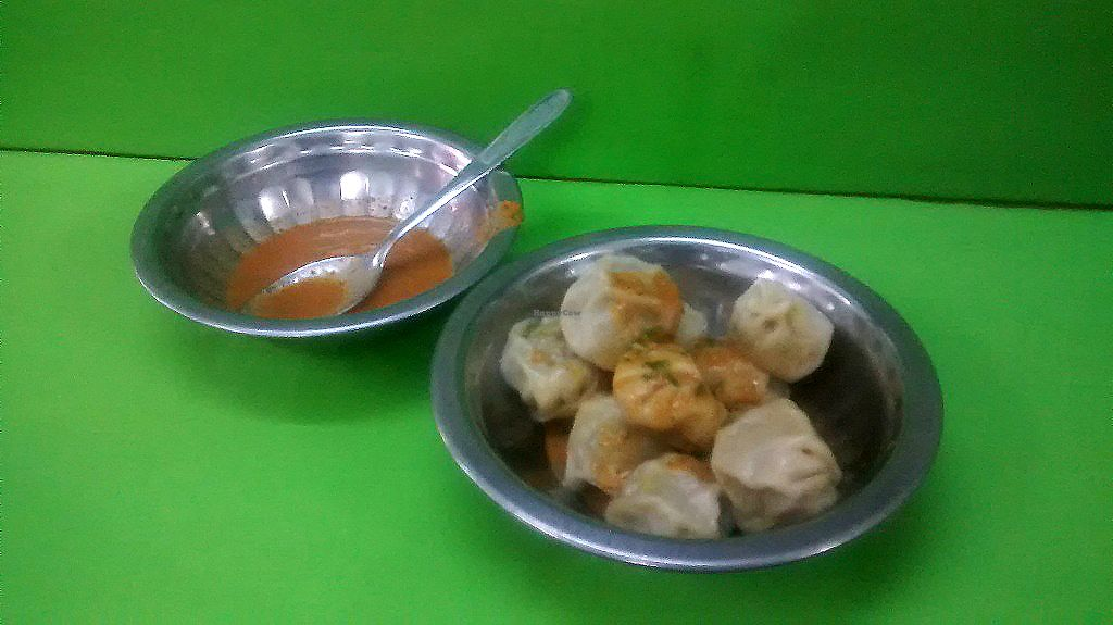 "Photo of Om's Veg Momo  by <a href=""/members/profile/Masala-Dosa"">Masala-Dosa</a> <br/>veg momo and tomato peanut sauce <br/> October 26, 2017  - <a href='/contact/abuse/image/11239/318993'>Report</a>"