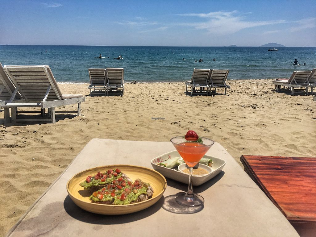 """Photo of The Fisherman Vegan Restaurant   by <a href=""""/members/profile/emmarenee"""">emmarenee</a> <br/>Food brought to us on the beach - Simmer Time cocktail, avocado toast and spring roll <br/> May 23, 2018  - <a href='/contact/abuse/image/113002/403741'>Report</a>"""
