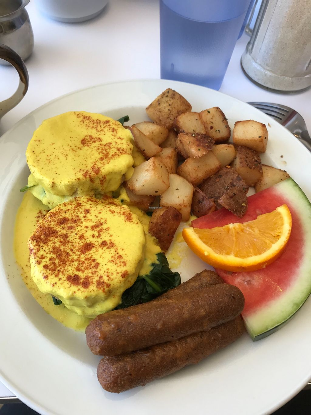 """Photo of The Planet Diner  by <a href=""""/members/profile/VeganQC"""">VeganQC</a> <br/>Tofu Benny and faux sausage.  <br/> May 14, 2018  - <a href='/contact/abuse/image/113075/399435'>Report</a>"""