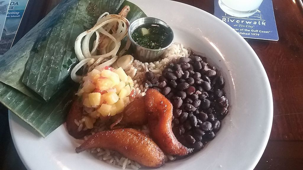 """Photo of Riverwalk at Tin City  by <a href=""""/members/profile/mshelene"""">mshelene</a> <br/>""""Key West Banana Leaf"""" meal on their Blue Zone Menu. It has sweet plantains, black beans, steamed rice, pineapple salsa, onions and chimichurri sauce. (which tasted like pesto) <br/> February 28, 2018  - <a href='/contact/abuse/image/113203/364741'>Report</a>"""