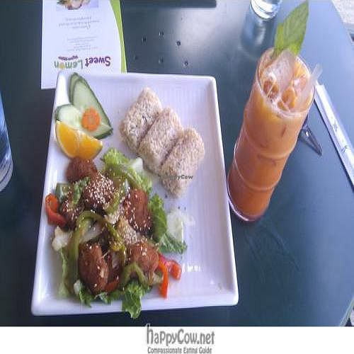 """Photo of Sweet Lemon Vegan Bistro  by <a href=""""/members/profile/katypine"""">katypine</a> <br/>sesame soy chunks, salad, brown rice, thai iced tea! <br/> September 12, 2011  - <a href='/contact/abuse/image/11468/10584'>Report</a>"""