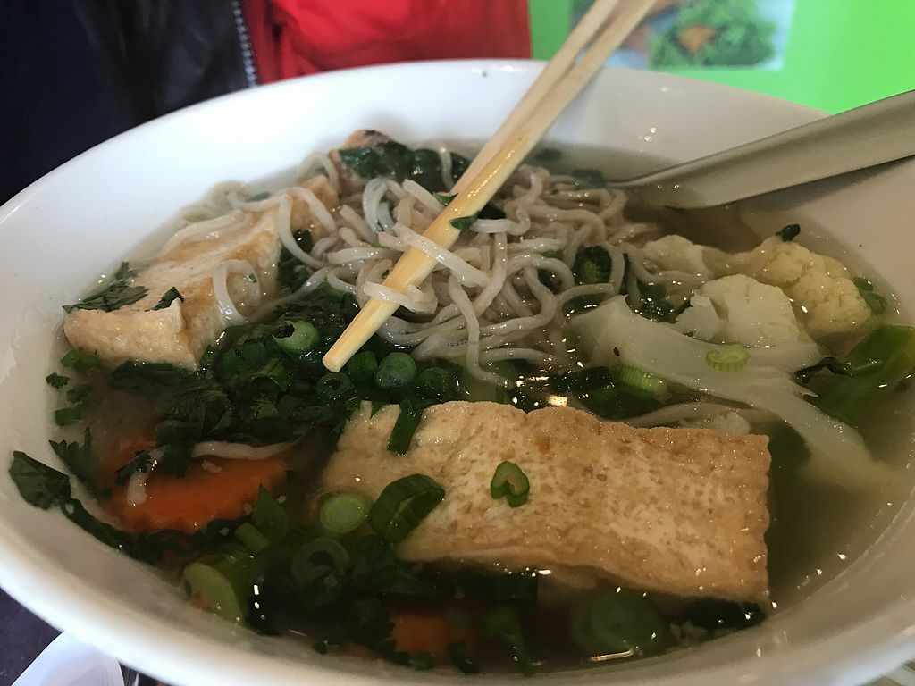 """Photo of Sweet Lemon Vegan Bistro  by <a href=""""/members/profile/Tata"""">Tata</a> <br/>This golden vegan egg noodle soup with dumplings is the best noodle soup we have ever had! We ordered one more right after we took the first bite! Must try <br/> November 5, 2017  - <a href='/contact/abuse/image/11468/322023'>Report</a>"""
