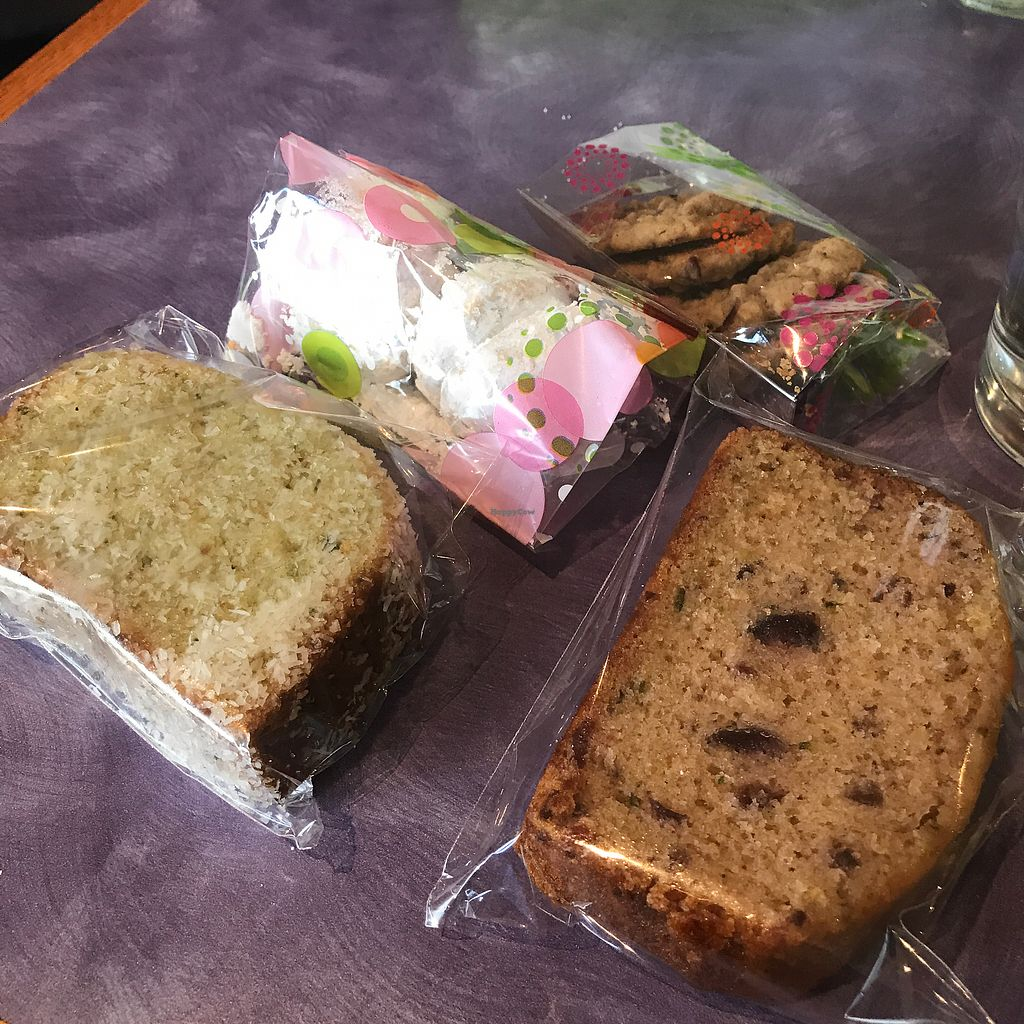 """Photo of Sweet Lemon Vegan Bistro  by <a href=""""/members/profile/Tata"""">Tata</a> <br/>The currant pound cake (on the right) was so moist, soft and amazing. The powdered sugar cookies (Mexican Wedding cookies) were also amazing. The chocolate chip was ok, but the coconut/pandan pound cake (on the left) was too dry <br/> November 5, 2017  - <a href='/contact/abuse/image/11468/322029'>Report</a>"""