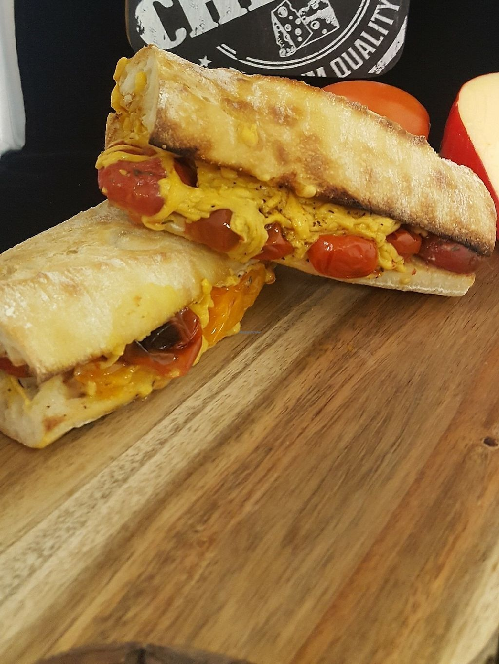 """Photo of Melted Co.  by <a href=""""/members/profile/KFurr"""">KFurr</a> <br/>Grandpas Amped Up Samich. Marinated tomatoes and Vegan cheddar. Awesome! <br/> March 21, 2018  - <a href='/contact/abuse/image/114733/374073'>Report</a>"""