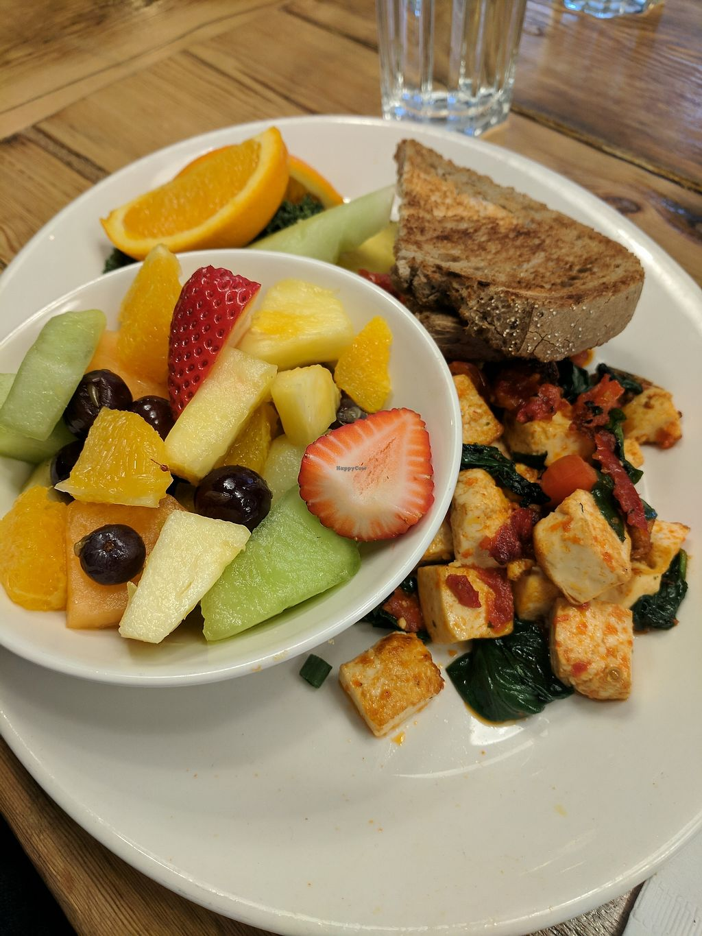 "Photo of Red's Diner  by <a href=""/members/profile/lmcc"">lmcc</a> <br/>Vegan tofu scramble with vegan rye bread and fruit  <br/> March 17, 2018  - <a href='/contact/abuse/image/114857/372153'>Report</a>"